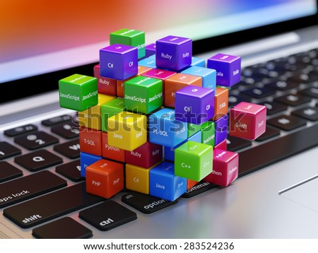 Programming concept. Different machine code languages colorful boxes on the laptop computer keyboard - stock photo