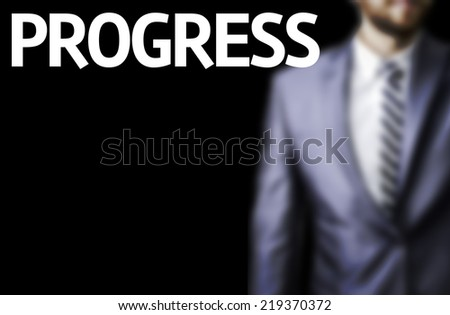Progress written on a board with a business man on background - stock photo