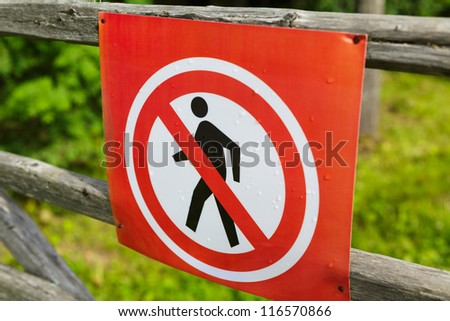 Prohibition sign on a wooden fence