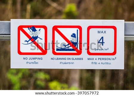 Prohibition signs are in English and Thailand. - stock photo