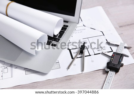 Project drawing and laptop, close up - stock photo