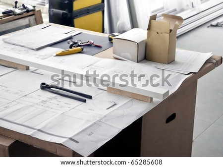 Project engineering plan with calipers over it - stock photo