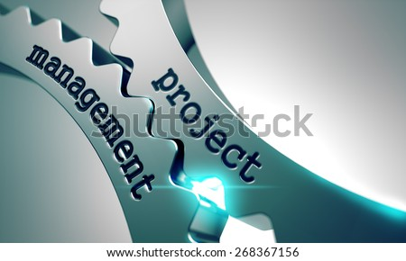 Project Management Concept on the Mechanism of Metal Cogwheels. - stock photo