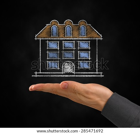 Project of a Home. Drawing of a symbolic apartment building under the facing up palm of a men's hand. Photo and graphic compositing.  - stock photo