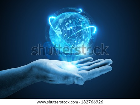 Projecting The Future. A hand holding a holographic projection. - stock photo