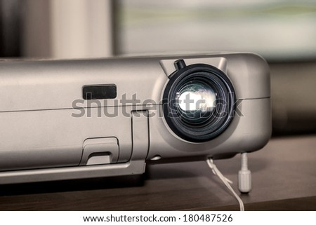 Projector on office table ready for presentation - stock photo
