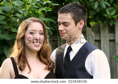 Prom Boy Smiling At Beautiful Date - stock photo