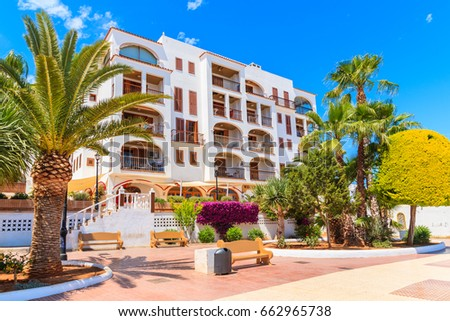 Promenade And Apartments In Traditional Colonial Spanish Style Building In  Santa Eularia Town, Ibiza Island