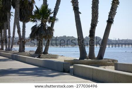 Promenade at Public city Beach in San Buena Ventura and wooden pier, Ventura, CA; Backlit, Back Lit - stock photo