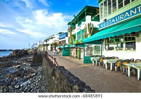 promenade of scenic Playa Blanca with seaside in the morning - stock photo