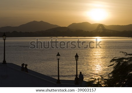 Promenade with Bridge of the Americas in the background - stock photo