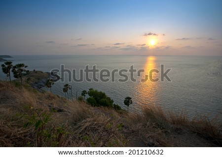 Promthep Cape is a mountain of rock that extends into the sea in Phuket, Thailand  - stock photo