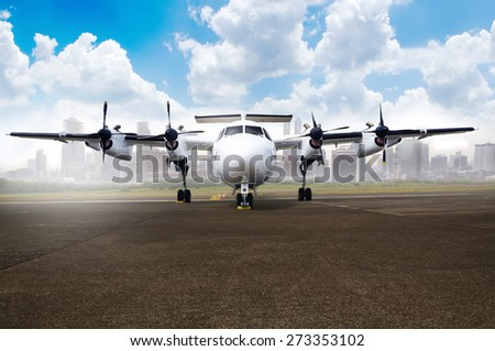 Propeller airplane parking at the airport. With blue sky and cloud background - stock photo