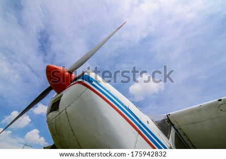propeller by a plane against blue sky - stock photo