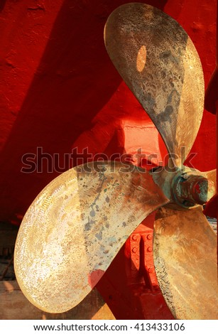 Propeller of a fishing boat in a shipyard for maintenance. - stock photo
