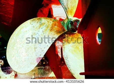 Propeller of a fishing boat in a shipyard for maintenance .Lomography style. - stock photo