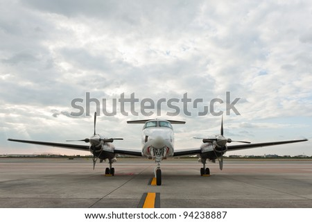Propeller plane parking at the airport - stock photo