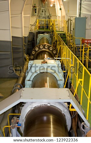 Propeller shaft of the large container ship - stock photo