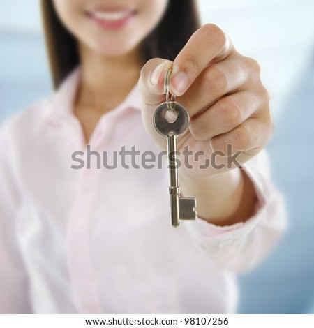 Property Agent holding a key - stock photo
