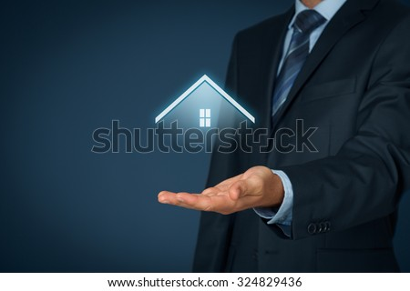 Property insurance and real estate agent concept. Care and giving gesture of man and symbol of house. - stock photo