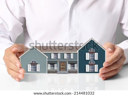 property insurance concept , man protect model of the house