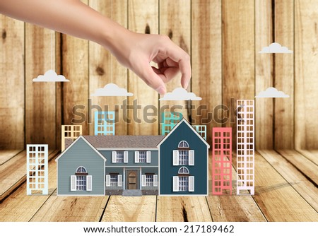 property insurance concept , man protect model of the house - stock photo