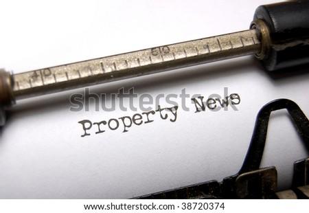 Property news written on an old typewriter - stock photo