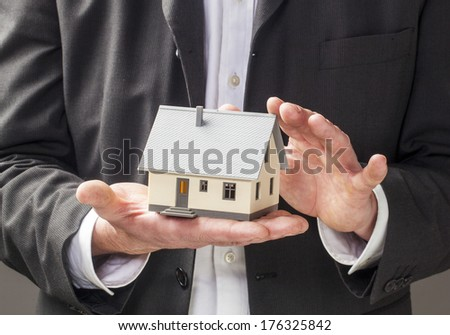 property owner holding hands - stock photo