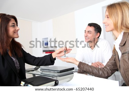 Property owners getting keys of their home - stock photo