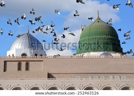 Prophet Muhammed holy mosque and pigeons flying in the sky in Medina, KSA - stock photo