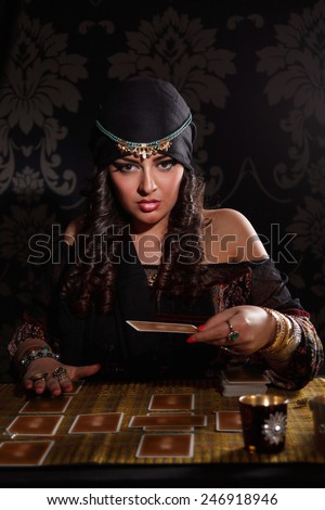 Prophetess woman with cards - stock photo