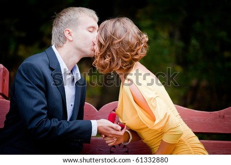 Proposal in an autumn park - stock photo