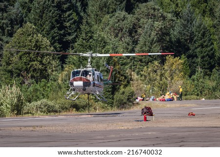 Prospect State Airport, Oregon  - September 9 : Helicopters on the runway ready to fight the 790 fire,September 9 2014 in Prospect State Airport, Prospect Oregon