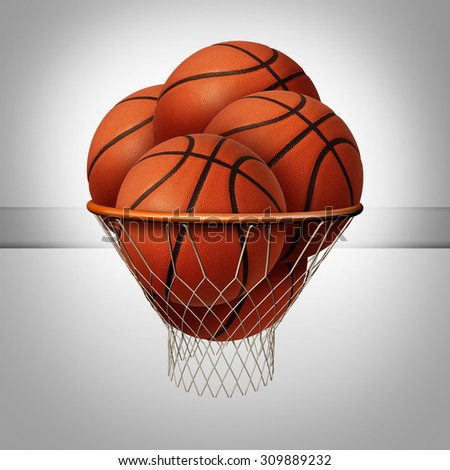 Prosperity concept and over the top success symbol as a group of basketballs inside a basketball net as an icon for excessive profit as a business metaphor. - stock photo