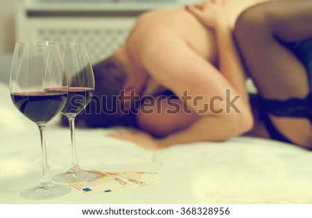 Prostitute working with client at her place. - stock photo