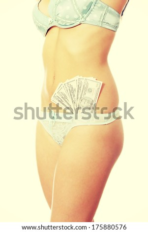 Prostitution concept - woman with cash in lingerie - stock photo
