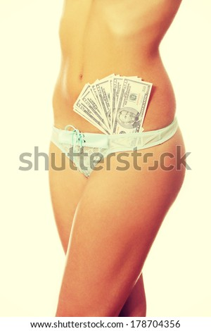 Prostitution concept - woman with cash in panties - stock photo