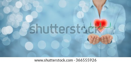 Protect health (healthcare) and heart problems prevention (cardiology) concept. Cardiologist with protective gesture and symbol of heart and ECG heartbeat, wide banner with bokeh in background.  - stock photo