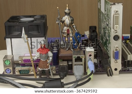 Protecting your computer from attack. Firewalls against hacking. Knight preventing safe access. Components mother board of the computer. - stock photo