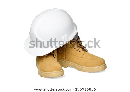 Protection helmet and boots isolated over white with clipping path. - stock photo