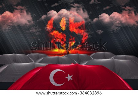 Protection Umbrella with flag of Turkey on a money war background - stock photo