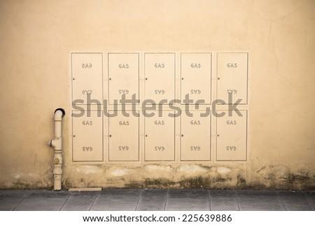 Protective metal Box of gas meter in a condominium building - stock photo
