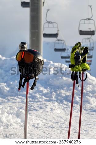 Protective sports equipment on ski poles at ski resort - stock photo