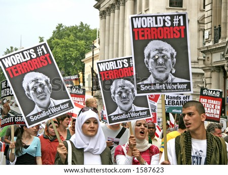 Protest march in London. Anti George Bush banners - stock photo