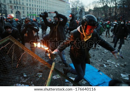 Protester runs with a Molotov cocktail. Kyiv, Ukraine, January 20, 2014