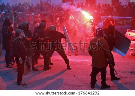 Protesters with fireworks attack the police. Kyiv, Ukraine, January 19, 2014 - stock photo