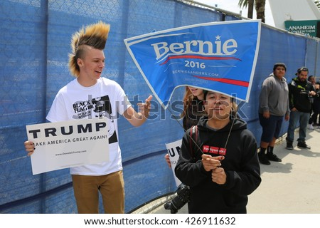 Protesters yell argue with supporters waves signs and cause trouble for the police at the Republican Presidential  Candidate Donald J. Trump rally. 5.25.2016 - stock photo