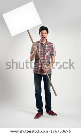 Protesting man with placard - stock photo