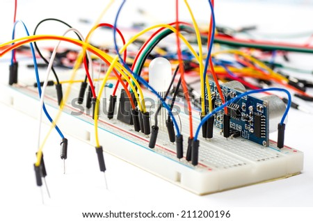 Prototyping electronic board with some components and wires - stock photo