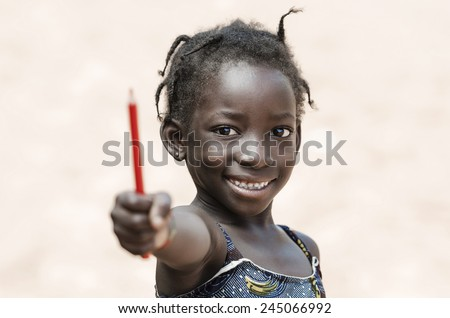 Proud African School Girl Education Symbol Showing Pencil  - stock photo